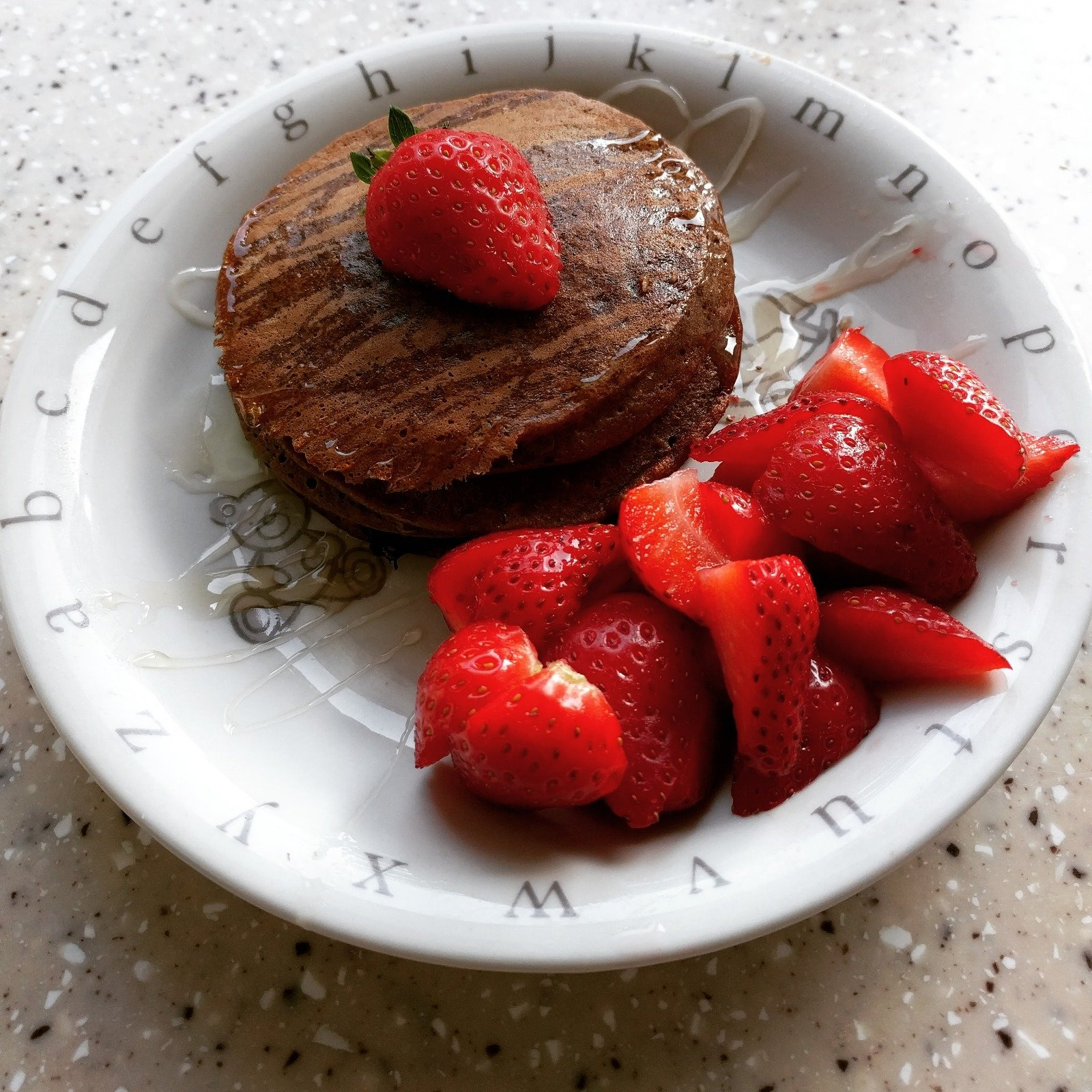 Pancakes and strawberries in a bowl